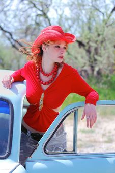 The Girl In Red And Old Car Stock Image