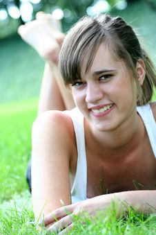 Free Woman Lying On Grass, Smiling Royalty Free Stock Image - 2826516