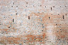 Free Stone And Brick Monastery Wall With Crenels Within Stock Photos - 28218743