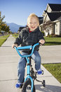 Free Little Boy Learning To Ride A Bike With Training Wheels Royalty Free Stock Image - 28227446