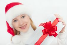 Free Woman And Christmas Present, White Gift With A Red Ribbon Royalty Free Stock Photography - 28237067