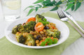 Free Warm Salad With Chickpeas, Broccoli And Raisins Stock Photos - 28252993