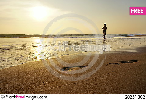 Free Woman Jogging Along The Edge Of The Ocean. Stock Photography - 28251302