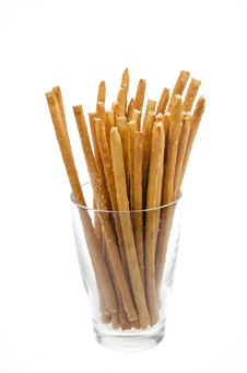 Free Bread Sticks With Salt In A Glass Beaker Isolated Stock Photos - 28252743
