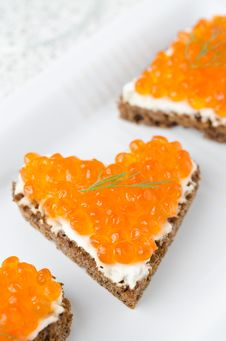 Sandwich With Red Caviar In The Form Of A Heart On White Plate, Stock Photos