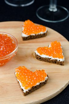 Free Three Sandwich With Red Caviar In The Form Of A Heart On A Woode Royalty Free Stock Photography - 28252947