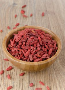 Wooden Bowl With Goji Berries Stock Images