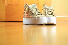 Free Pair Of Funky Used Sneakers Shoes On Hard Wood Floor Royalty Free Stock Photos - 28255838