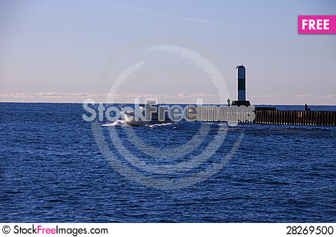 Free Boat Passing Lighthouse Stock Photo - 28269500