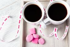 Free Two Coffee Cups With Pink Candies Stock Photo - 28262860