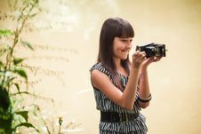 Girl With Antique Camera Stock Image