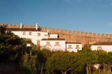 Old Beautiful Houses In Medieval City Of Obidos, Portugal Royalty Free Stock Photo