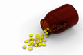 Free Yellow Pills Spilled From A Bottle Royalty Free Stock Images - 28285529