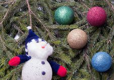 Colorful Balls And Snowman Lying On Spruce Branches. Stock Image