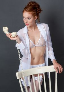 Woman In Lingerie Holding Old Telephone Stock Images