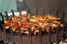 Fillet Pig And Roast Chicken Legs On Grill Royalty Free Stock Images