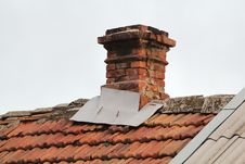 Free Old Pipe From The Furnace On The Roof Out Shingles, On Grey Sky Royalty Free Stock Photography - 28297857
