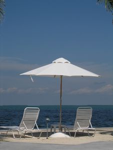 Free Waterfront Umbrella And Chairs Royalty Free Stock Image - 2833176
