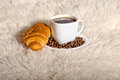Free Croissant With Coffee And Beans On Fur Background Royalty Free Stock Photography - 28329637