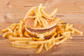 Free Hamburger And French Fries On Wooden Background Stock Images - 28329914