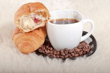 Croissant With Coffee And Beans On Fur Background Royalty Free Stock Image
