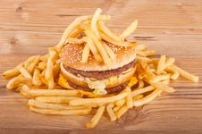 Hamburger And French Fries On Wooden Background Stock Images