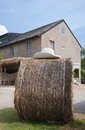 Free Straw Bale And Farmhouse In Background Royalty Free Stock Images - 28339409