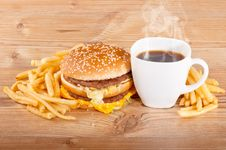 Breakfast Set: Coffee, Hamburger And French Fries On Wooden Background Royalty Free Stock Image