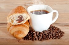 Croissant With Coffee And Beans On Wooden Background Stock Image