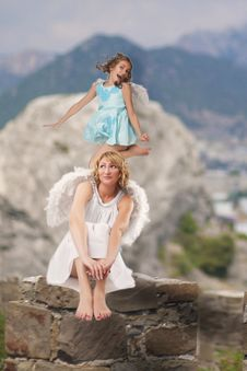 Jumping Angel Over Mountains Royalty Free Stock Images