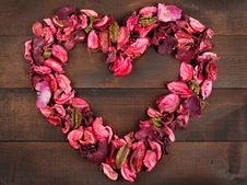 Flower Petals Forming A Heart Shape Royalty Free Stock Photo