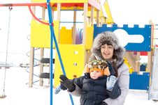 Free Happy Mother And Son In Winter Outfits Waving Stock Photos - 28358923