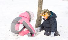 Free Two Young Children Digging In The Snow Royalty Free Stock Image - 28358926