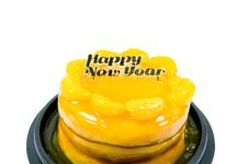 Orange Cake With Golden Happy New Year Text  Isolated Royalty Free Stock Photo