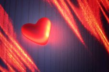 Red Heart In The Light Of The Laser Stock Images