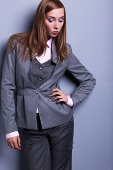 Graceful Stylish Woman In Grey Costume - Vogue Style Stock Image