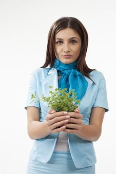 Free Cute Female Presenting Plants Royalty Free Stock Photography - 28388277