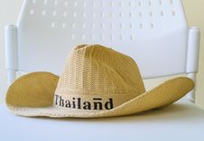 Free A Hat Is On A White Chair Royalty Free Stock Photography - 28395197