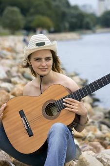 Free The Girl With A Guitar Royalty Free Stock Photos - 2846518