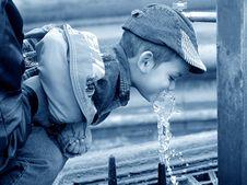 Free Little Boy Drinking Water Stock Photo - 2846680