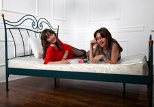 Free Two Young Girls Posing On The Bed Stock Photos - 28404193