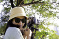 Free Smiling Girl With Camera On Nature. Stock Photos - 28415833