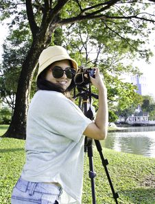 Free Beautiful Smiling Asian Girl With Camera Royalty Free Stock Image - 28415776