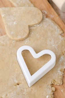 Free Cookie Cutters In The Form Of Heart In Cookie Dough Royalty Free Stock Photo - 28420035