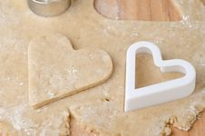 Heart Shaped Cookie Cutter On Raw Cookie Dough And A Heart-shape Stock Photo