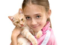 The Girl With A Red Kitten Royalty Free Stock Photo