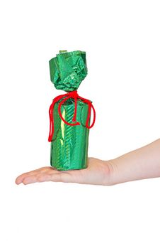 Holiday Gift In Bright Green Packaging On A Female Hand