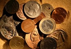 Free Coins In Sand Royalty Free Stock Photo - 28443945