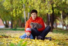Family With Cat In The Autumn Park Stock Photo