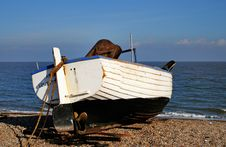 Free Boats Beached On A Shingle Beach Stock Photo - 28459610